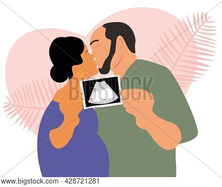 Young Parents Found Out The Gender Of Their Unborn Child. The Couple Holds An Ultrasound Picture In