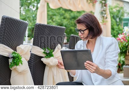 Woman Professional Decorator With Digital Tablet Working Outdoors Decorating Ceremony