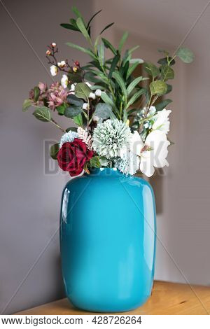 Stylish Blue Vase With Fake Flower Arrangement Modern Decoration In Luxury Home On Wooden Table, Bea