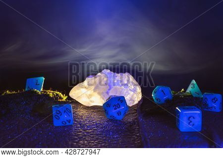 Image Of A Glowing Salt Crystal Surrounded By Blue Role Role-playing Dice Within The Background Silk