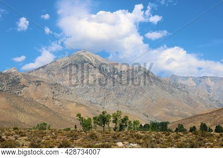 Cumulus Clouds Above The Sierra Nevada Mountains Taken On The Arid Desert Floor Taken In The Great B