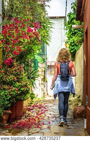 Street In Plaka District, Athens, Greece, Europe. Scenic Alley With Plants And Flowers In Athens Cit