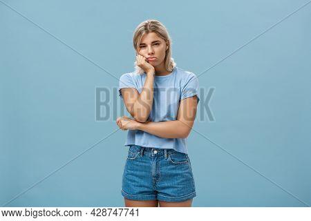 Studio Shot Of Displeased Moody Girlfriend Feeling Disappointed Boyfriend Spoilt Date Leaning Head O