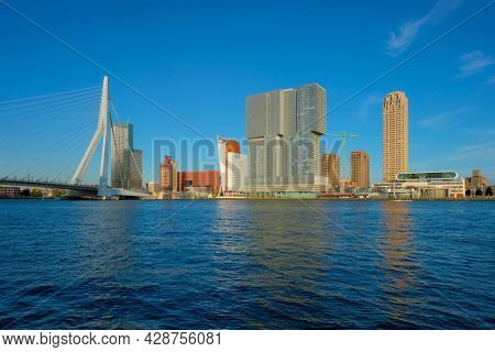 View of Rotterdam skyscrapers skyline and Erasmusbrug bridge view over of Nieuwe Maas river. Rotterdam, the Netherlands