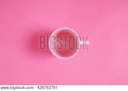 Pink Cup Of Water On A Pink Scene.simplicity Taken From A Bird's Eye View.light And Shadow In The St