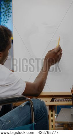 Black Young Artist With Disability Creating Vase Design On Canvas While Sitting In Artwork Studio Ro