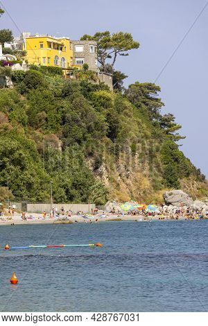 Capri Island, Italy - June 28, 2021: Beach On The Tyrrhenian Sea In The Gulf Of Naples Off The Coast