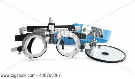 Trial Frame And Head Mirror On White Background. Ophthalmologist Tools