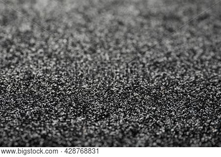 Shiny Grey Glitter As Background. Bokeh Effect