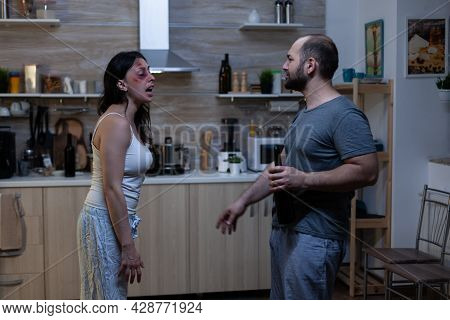 Husband And Wife Fighting And Screaming At Home. Man Dealing With Alcohol Addiction And Violence Whi