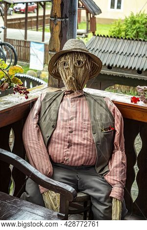Criseni, Harghita, Romania-june 20: The Straw Man - Decoration In The Courtyard Of The Straw Hat Mus
