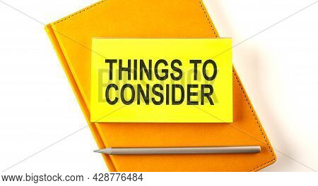 Text Things To Consider On Sticker On Yellow Notebook