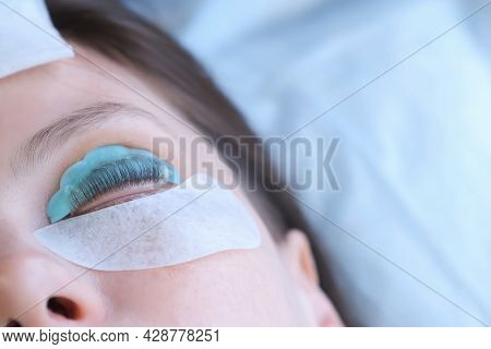Young Woman On Lash Lifting Laminating Procedure In Beauty Salon With Closed Eyes. She Is Lying With