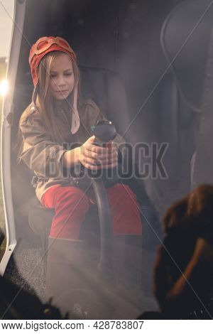Tween Girl Holding Control Handle In Helicopter Cockpit