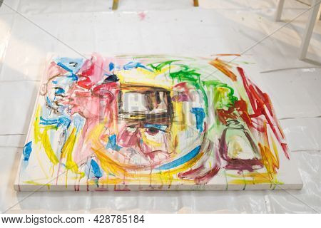 Modern abstract oil painting on canvas in artists studio. creation and inspiration at an artists painting studio.