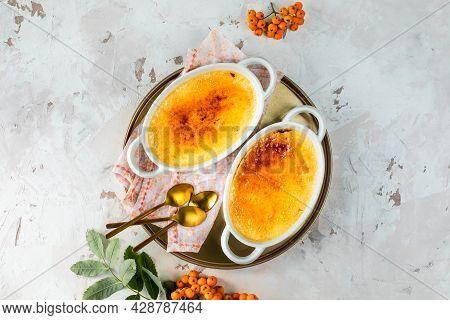 Creme Brulee Dessert With Cream In White Baking Dishes, Delicious Autumn Dessert.