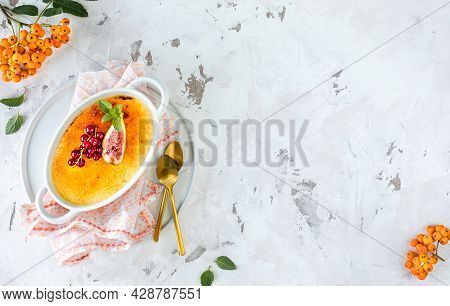 Recipe For Creme Brulee Dessert With Fresh Figs And Currants On A White Plate In An Autumn Compositi