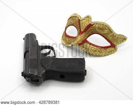 Gun, Pistol, Traditional Golden Carnival Venetian Mask With Red Ornament. Preparation For The Brazil