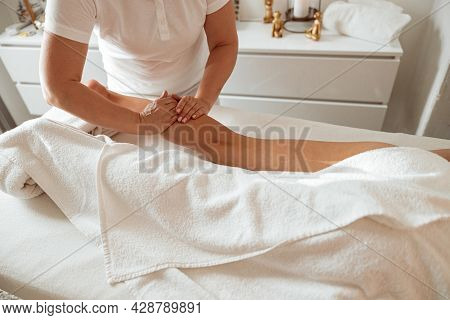 Young Woman Receiving Therapeutic Massage At Wellness Center
