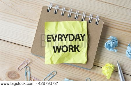 Everyday Work. Text On White Paper On Wooden Background