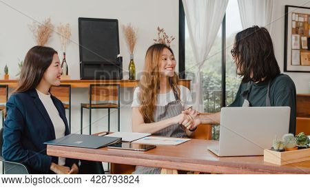 Cheerful Asian Small Business Owners Couple Meeting With Consultant Talking About Business Plan And