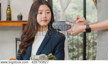 Young Asian Business Women Pay Contactless At Coffee Shop. Asian Happy Girl Barista Waiter Wear Gray