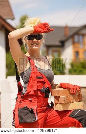 Strong Pretty Woman Working On Construction Site, Building House, Installing Bricks. Industrial Work