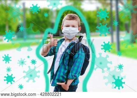 Schoolboy In A Protective Mask On The Street On The Way To School. Protective Shell, Viruses Fly Aro