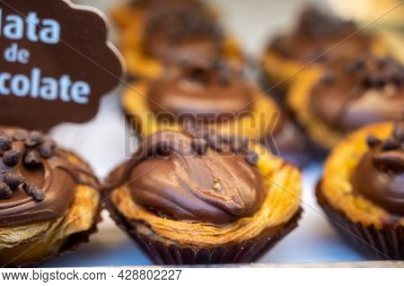 Traditional Dessert Pastry In Portugal, Nata Eggs Cream Cakes With Chocolate
