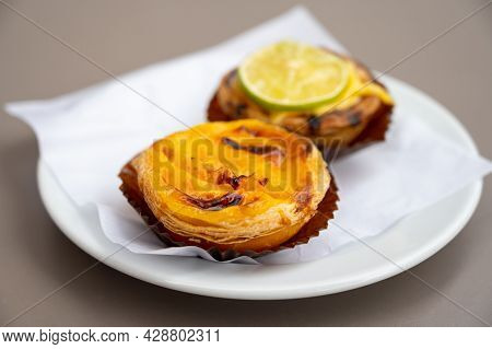 Traditional Dessert Pastry In Portugal, Nata Eggs Cream Cakes With Fruits