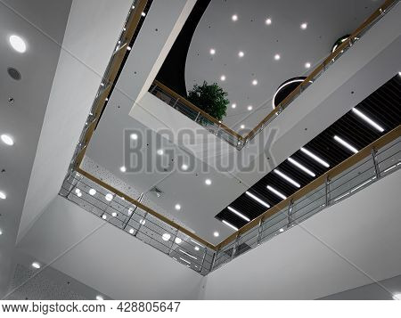 Interior Of A Modern Building. Inside Office Quarter. Shopping Mall Lobby. Abstract Design. White An