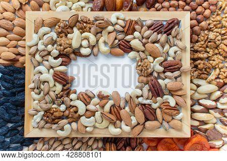 Assorted Nuts: Almonds, Pistachio, Cashews, Walnut. Flatlay Organic Mixed Nuts Background. Healthy F