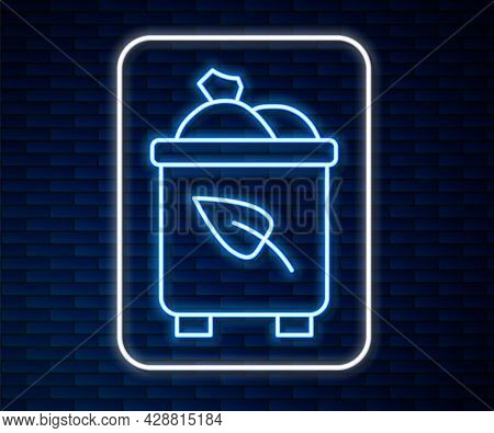 Glowing Neon Line Recycle Bin With Recycle Symbol Icon Isolated On Brick Wall Background. Trash Can