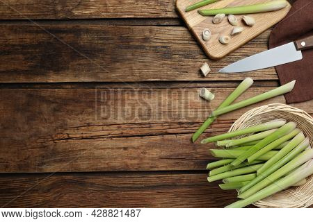 Fresh Lemongrass, Knife And Cutting Board On Wooden Table, Flat Lay. Space For Text