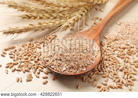 Wheat Bran And Kernels On Wooden Table, Closeup