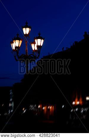 Street Lantern Electric Illumination Night City After Sunset With Dark Blue Sky View And Background