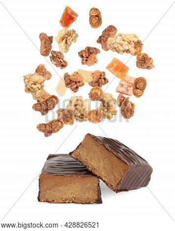 Tasty Chocolate Glazed Protein Bars And Granola With Dried Fruits Falling On White Background