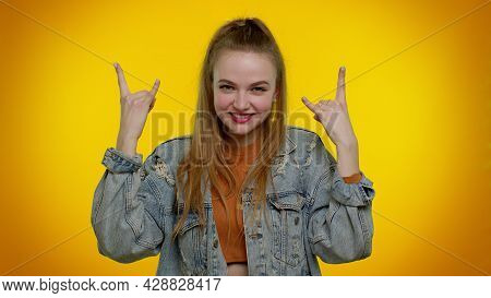 Rock N Roll. Overjoyed Delighted Sincere Teen Girl 20s Years Old In Denim Jacket Showing Gesture By