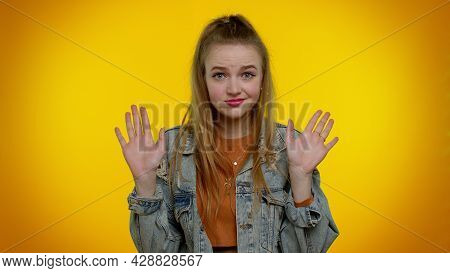 I Am Not Guilty. Portrait Of Teenager Student Girl 20s Years Old In Denim Jacket Pointing Fingers Hi