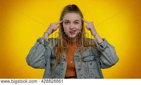 You Are Crazy, Out Of Mind. Teen Girl In Denim Jacket Pointing At Camera And Showing Stupid Gesture,
