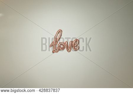 Pink Foil Air Inscription. Air Foil Balloon On A Gray Background. Valentines Day