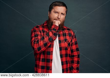 Bored, Indifferent Handsome Bearded Guy With Stylish Hipster Haircut Feeling Unamused And Uninterest