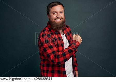 Success, Achievement And Satisfaction Concept. Pleased Bearded Hipster Male In Red Checkered Shirt,