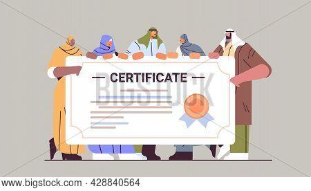 Arab Graduated Students Standing Together Near Certificate Arabic Graduates Celebrating Academic Dip