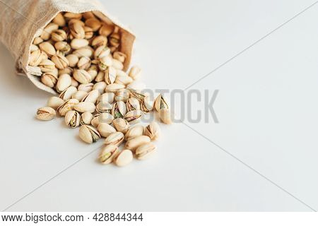 Pile Of Pistachios On The Light Background. Pistachio Is A Healthy Vegetarian Protein Nutritious Foo