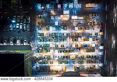 Aerial View Of Flea Market And Food Fair In Chiang Mai City At Weekend Night. That Marketplace Consi