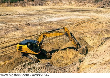 Closeup Of An Industrial Excavator Working In A Cave Quarry. Industry, Technology, Mining. Heavy Ind