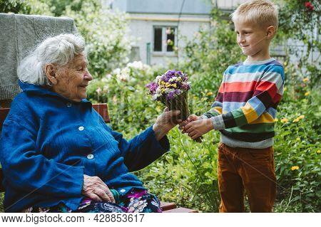Reunited, Family, Togetherness, Relationships, Meeting, Embracing. Grandson Visit Grandmother Gives