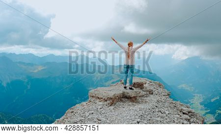 Young Woman With Outstretched Arms Enjoying The Beauty Of Nature On Mountain Rock. Fantastic Landsca