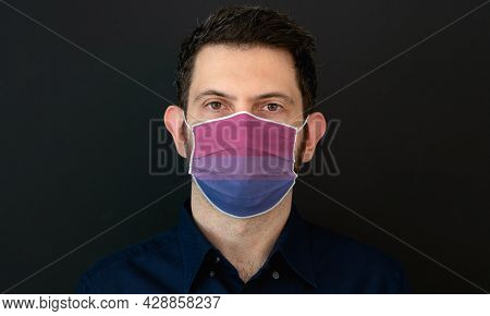 Portrait Of An Adult Man Wearing Algbt Bisexual Flag Colors Facial Mask. Lgbt Gay Rights Concept Wit